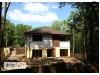 Проект двухэтажного дома простой формы с антресолью над гостиной и встроенным гаражом - ZX2